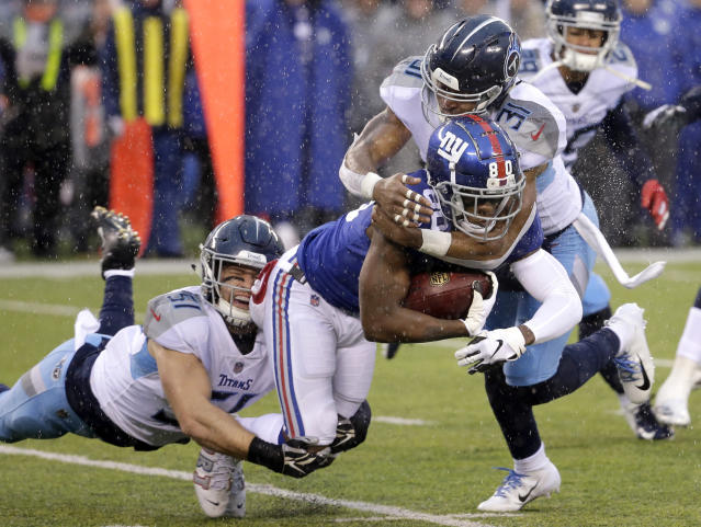New York Giants wide receiver Jawill Davis, center, is tackled by Tennessee Titans inside linebacker Will Compton, left, and free safety Kevin Byard during the first half of an NFL football game Sunday, Dec. 16, 2018, in East Rutherford, N.J. (AP Photo)