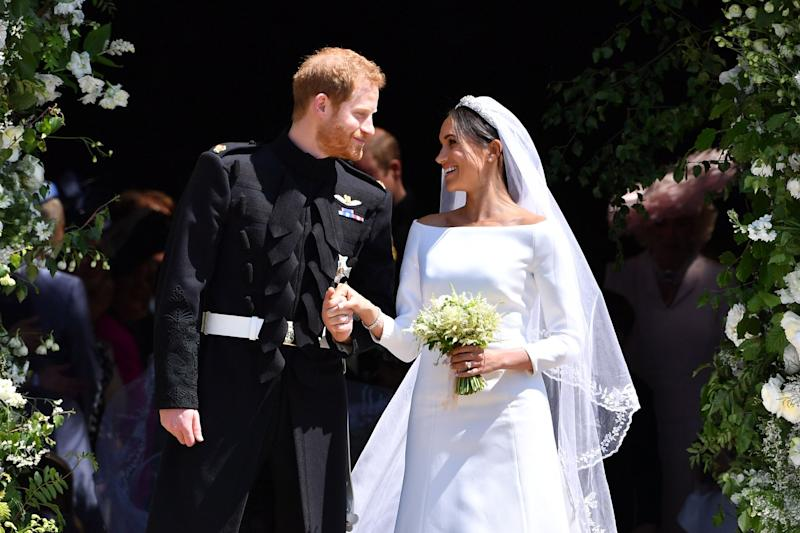 TOPSHOT - Britain's Prince Harry, Duke of Sussex and his wife Meghan, Duchess of Sussex emerge from the West Door of St George's Chapel, Windsor Castle, in Windsor, on May 19, 2018 after their wedding ceremony. (Photo by Ben STANSALL / various sources / AFP) (Photo credit should read BEN STANSALL/AFP/Getty Images)