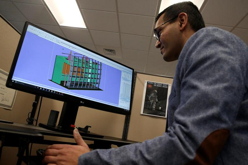Product Development Engineer Jigar Patel works with a CAD image of a thrust reverser cascade in development at Oxford Performance Materials Inc., in South Windsor, Connecticut