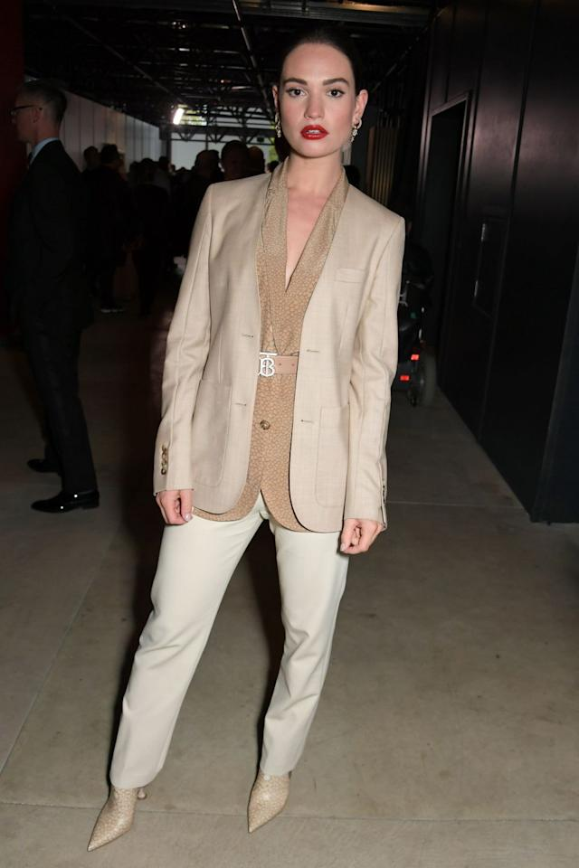 <p>The actress wore head-to-toe cream Burberry, including a monogrammed belt, to the SS20 show during London Fashion Week.</p>
