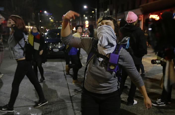 <p>A woman yells as she takes part in a protest against President-elect Donald Trump, Wednesday, Nov. 9, 2016, in Seattle's Capitol Hill neighborhood. (Photo: Ted S. Warren/AP) </p>