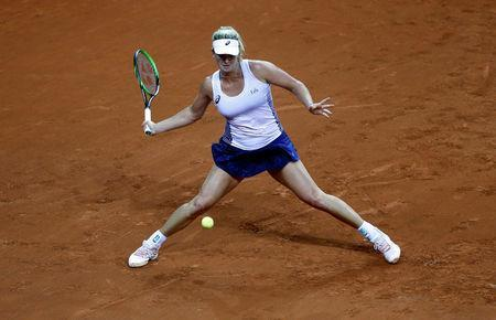 Tennis - Fed Cup - World Group Semi Final - France vs United States - Arena Du Pays D'Aix, Aix-en-Provence, France - April 21, 2018 CoCo Vandeweghe of the U.S. in action during her match against France's Kristina Mladenovic REUTERS/Jean-Paul Pelissier