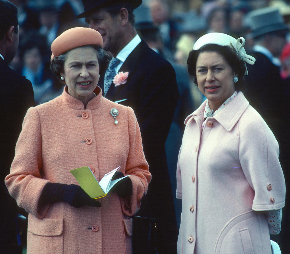 Queen Elizabeth ll and her sister Princess Margaret attend the Epsom Derby on June 06, 1979 in Epsom, England. (Photo by Anwar Hussein/Getty Images)