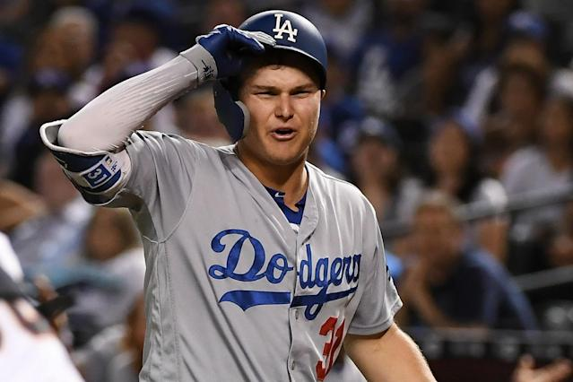 "Joc Pederson and the <a class=""link rapid-noclick-resp"" href=""/mlb/teams/la-dodgers/"" data-ylk=""slk:Dodgers"">Dodgers</a> don't seem thrilled about the new pitch clock, but they also don't seem to notice it much. (Getty)"