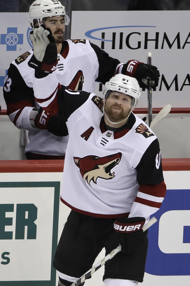 Two-time Stanley Cup Champion with the Pittsburgh Penguins, Arizona Coyotes' Phil Kessel (81) acknowledges fans during a tribute to his time with the Penguins during a timeout in the first period of an NHL hockey game against the Penguins in Pittsburgh, Friday, Dec. 6, 2019. (AP Photo/Gene J. Puskar)