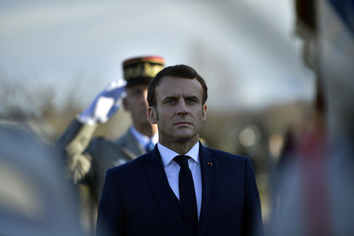 French President Emmanuel Macron attends a ceremony in tribute to French soldiers who died in Mali helicopter crash, Monday Jan.13, 2020 in Pau, southwestern France. France is preparing its military to better target Islamic extremists in a West African region that has seen a surge of deadly violence. (AP Photo/Alvaro Barrientos, Pool)