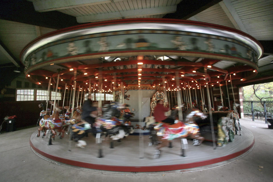 FILE - This Nov. 14, 2007 file photo shows the carousel in Central Park, in New York. New York City will terminate business contracts with President Donald Trump after last week's insurrection at the U.S. Capitol, Mayor Bill de Blasio announced Wednesday, Jan. 13, 2021. The Trump Organization is under city contract to operate the two ice rinks and a carousel in Central Park as well as a golf course in the Bronx. (AP Photo/Bebeto Matthews, File)