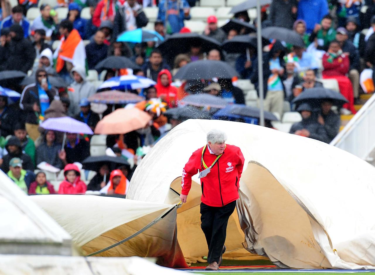 Covers come on as rain delays play during the ICC Champions Trophy match at Edgbaston, Birmingham.
