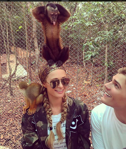 "<p>The socialite and her boyfriend, Chris Zylka, met some new friends to monkey around with. ""Had the best time at the @AkumalMonkeySanctuary,"" she wrote.""Amazing what they do for all these rescued animals."" (Photo: <a rel=""nofollow"" href=""https://www.instagram.com/p/BZuta4UHS3k/?taken-by=parishilton"">Paris Hilton via Instagram</a>) </p>"