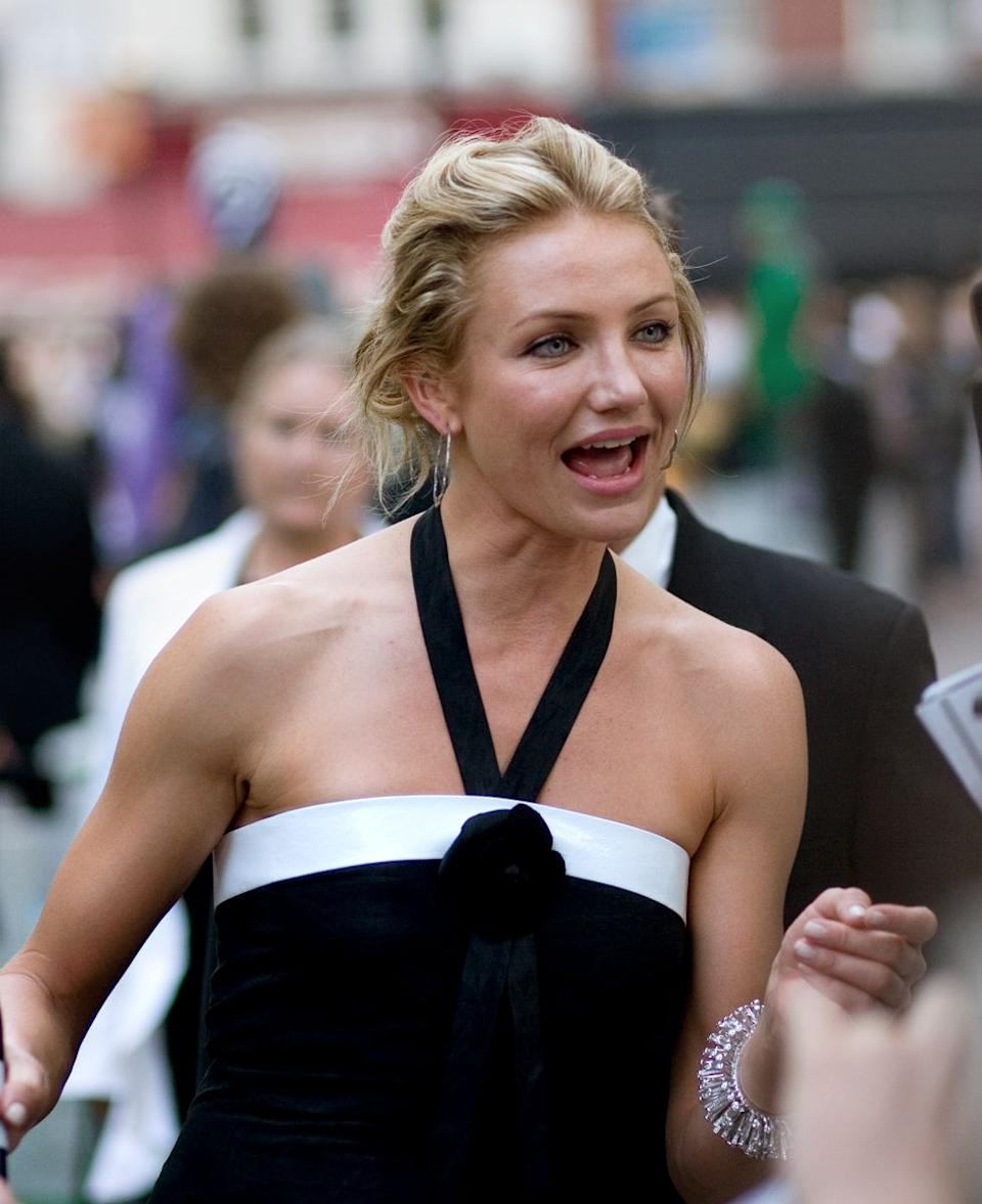 Cameron Diaz looks beautiful this black dress as she is caught on camera while speaking to someone