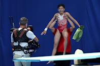 <p>Hongchan Quan of Team China celebrates after winning the gold in the Women's 10m Platform Final on day thirteen of the Tokyo 2020 Olympic Games at Tokyo Aquatics Centre on August 05, 2021 in Tokyo, Japan. (Photo by Clive Rose/Getty Images)</p>