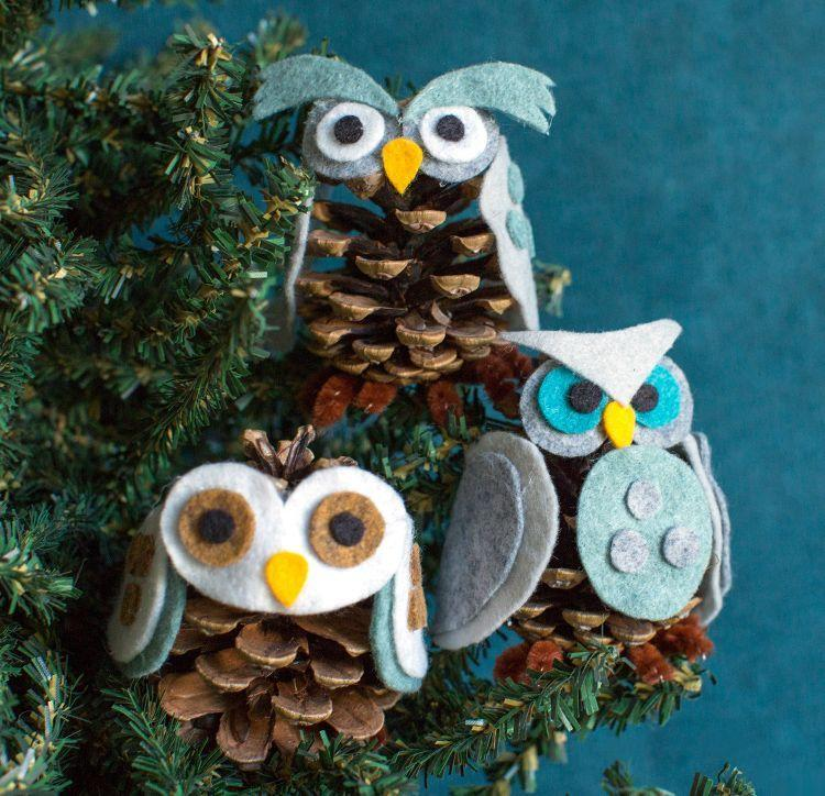 """<p>An owl belongs in your Christmas tree, wisely observing the holiday from above. With some felt and a pinecone, you can whip one up in a snap.</p><p> <em><a href=""""https://liagriffith.com/our-favorite-pinecone-owls-video/"""" rel=""""nofollow noopener"""" target=""""_blank"""" data-ylk=""""slk:Get the tutorial at Lia Griffith »"""" class=""""link rapid-noclick-resp"""">Get the tutorial at Lia Griffith »</a></em></p>"""