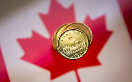 """FILE PHOTO: FILE PHOTO: A Canadian dollar coin commonly known as the """"Loonie"""" is pictured in this illustration picture taken in Toronto"""