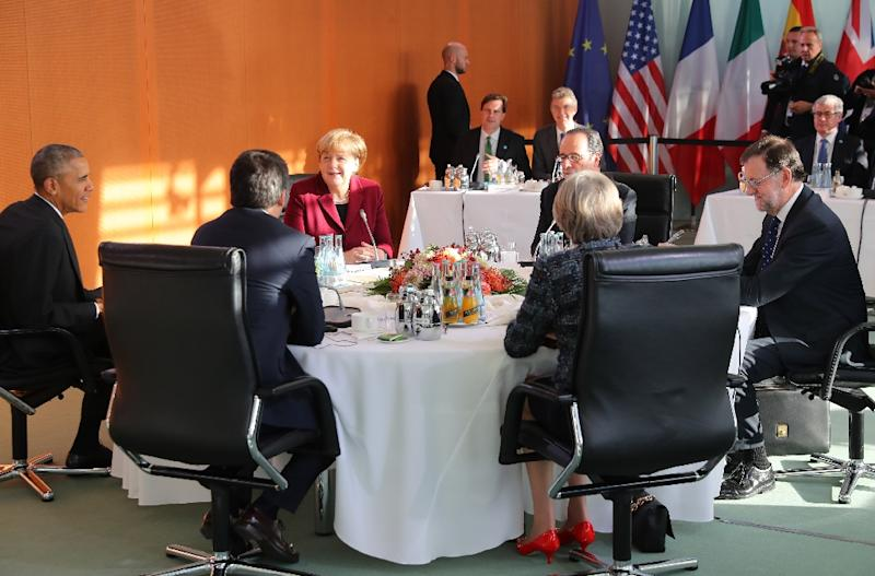 Underlining her relative strength, Angela Merkel gathered Obama and the leaders of Britain, France, Spain and Italy at her chancellery for talks on the fight against terrorism, climate change and the strategic threat posed by Russia (AFP Photo/Kay Nietfeld)