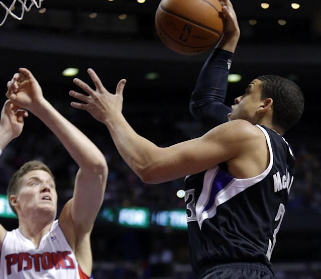 Sacramento Kings guard Ray McCallum (3) goes to the basket against Detroit Pistons forward Jonas Jerebko (33) during the first half of an NBA basketball game, Tuesday, March 11, 2014, in Auburn Hills, Mich. (AP Photo/Duane Burleson)