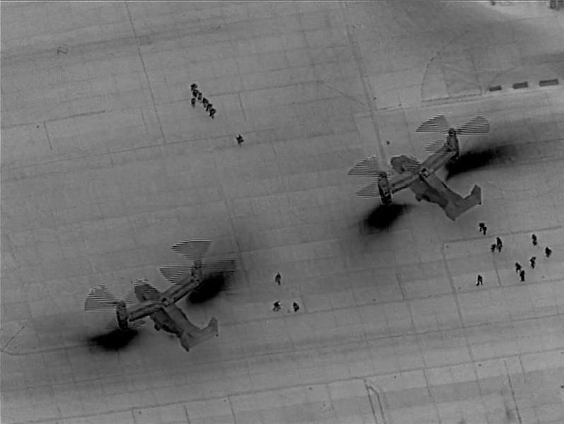 U.S. Marine Corps MV-22 Ospreys drop off crisis reponse forces at the U.S. Embassy in Baghdad