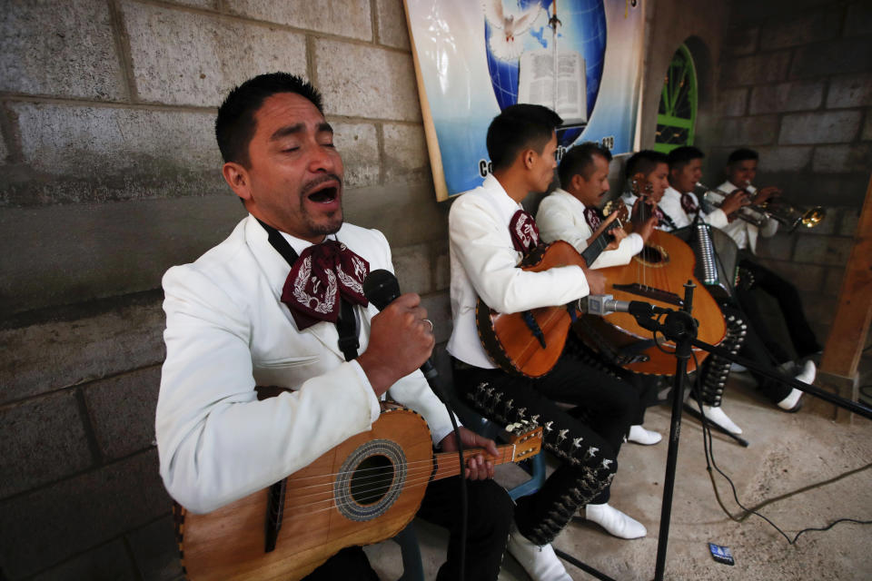Mariachis perform at the wake celebrating the life of Elfego Miranda Diaz, one the Guatemalan migrants who was killed near the U.S.-Mexico border in January, in his home in Comitancillo, Guatemala, Saturday, March 13, 2021. Thousands of residents of this Guatemalan town turned out Friday night amid tears and applause to receive the remains of 16 of their own, found piled in a charred pickup truck in Camargo, across the Rio Grande from Texas. (AP Photo/Moises Castillo)
