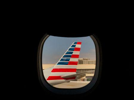 FILE PHOTO: An American Airlines airplane sits on the tarmac at LAX in Los Angeles, California, U.S., March 4, 2019. REUTERS/Lucy Nicholson/File Photo