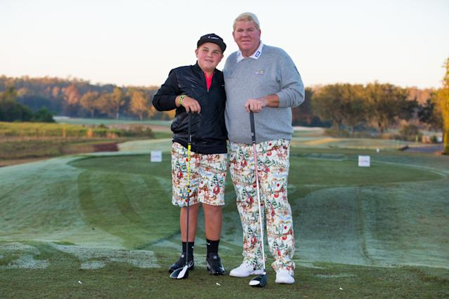"""<h1 class=""""title"""">PNC Father/Son Challenge - Round One</h1> <div class=""""caption""""> ORLANDO, FL - DECEMBER 14: John Daly and his son Little John pose for a photo on the 10th tee during the first round of the PNC Father/Son Challenge at The Ritz-Carlton Golf Club on December 14, 2017 in Orlando, Florida. (Photo by Manuela Davies/Getty Images) </div> <cite class=""""credit"""">Manuela Davies</cite>"""
