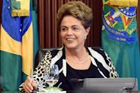 Brazilian President Dilma Rousseff gestures during a ministerial meeting at Planalto Palace in Brasilia on December 3, 2015 (AFP Photo/Evaristo Sa)