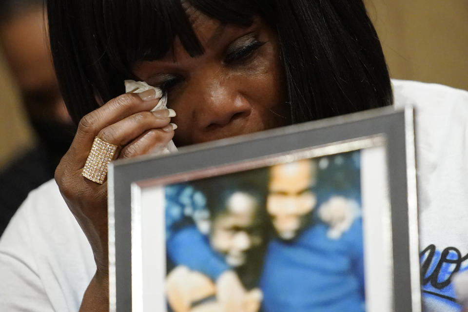 Robyn Williams, sister of Byron Williams, cries during a news conference, Thursday, July 15, 2021, in Las Vegas. The family of 50-year-old Byron Williams, whose death in Las Vegas police custody after a bicycle chase in 2019 was ruled a homicide, is suing the city and four officers they accuse of wrongful death and civil rights violations. (AP Photo/John Locher)