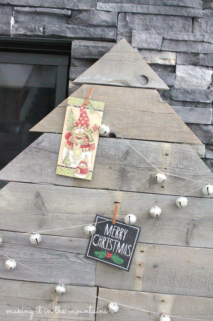 """<p>Searching for a creative way to display the holiday cards collecting on your counter? Look no further! The silver bell garland on this wide-pallet Christmas tree makes it easy to display a dozen or more.</p><p><strong>Get the tutorial at <a href=""""https://www.makingitinthemountains.com/rustic-pallet-wood-christmas-card-tree-day-ten-12-posts-christmas/"""" rel=""""nofollow noopener"""" target=""""_blank"""" data-ylk=""""slk:Making It in the Mountains"""" class=""""link rapid-noclick-resp"""">Making It in the Mountains</a>.</strong></p><p><strong><a class=""""link rapid-noclick-resp"""" href=""""https://www.amazon.com/Darice-1099-21-30-Piece-4-Inch-Silver/dp/B003W0CVP2/?tag=syn-yahoo-20&ascsubtag=%5Bartid%7C10050.g.23322271%5Bsrc%7Cyahoo-us"""" rel=""""nofollow noopener"""" target=""""_blank"""" data-ylk=""""slk:SHOP SILVER BELLS"""">SHOP SILVER BELLS</a><br></strong></p>"""