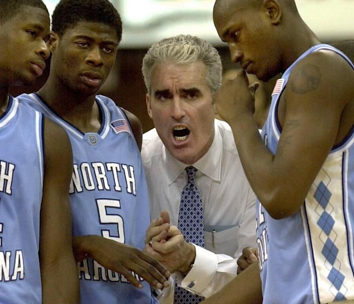 """Matt Doherty (center) was UNC's head basketball coach from 2000-2003 before being forced to resign after a stormy tenure. He has written a new leadership book called """"Rebound"""" that details those years."""