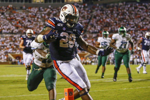 Auburn running back JaTarvious Whitlow (28) carries the ball in for a touchdown during the second half of the team's NCAA college football game against Tulane, Saturday, Sept. 7, 2019, in Auburn, Ala. (AP Photo/Butch Dill)