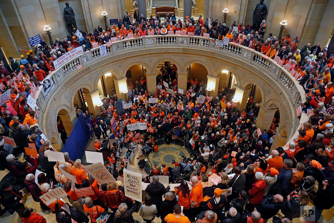 <p>Hundreds gather in the State Capitol rotunda during a rally in St. Paul, Minn., where concerned citizens are calling for the passage of four bills they believe would substantively reduce gun violence in the state. (AP Photo/Jim Mone) </p>