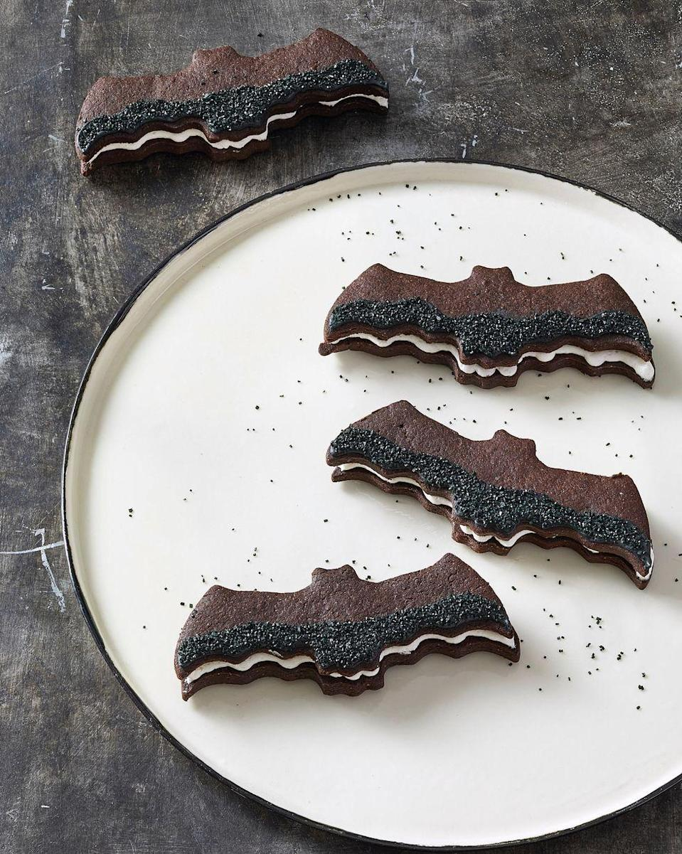 """<p>Give your favorite sandwich cookie a Halloween makeover with these deep dark chocolate cookies and vanilla buttercream.</p><p><em><a href=""""https://www.goodhousekeeping.com/food-recipes/party-ideas/a28609240/bat-sandwich-cookies-recipe/"""" rel=""""nofollow noopener"""" target=""""_blank"""" data-ylk=""""slk:Get the recipe for Bat Sandwich Cookies »"""" class=""""link rapid-noclick-resp"""">Get the recipe for Bat Sandwich Cookies »</a><br></em></p><p><strong>RELATED: </strong><a href=""""https://www.goodhousekeeping.com/holidays/halloween-ideas/g3676/easy-halloween-cookie-recipes/"""" rel=""""nofollow noopener"""" target=""""_blank"""" data-ylk=""""slk:42 Halloween Cookie Ideas That Are Frightfully Easy to Make"""" class=""""link rapid-noclick-resp"""">42 Halloween Cookie Ideas That Are Frightfully Easy to Make</a><br></p>"""