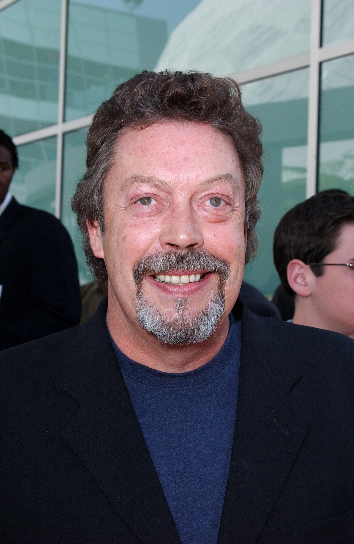 """Photo by: Lee Roth STAR MAX, Inc. - copyright 2003 ALL RIGHTS RESERVED Telephone/Fax (212) 995-1196 6/1/03 Tim Curry at the world premiere of """"Rugrats Go Wild"""". (Hollywood, CA) (Star Max via AP Images)"""