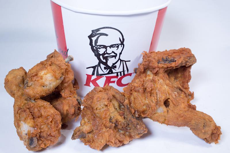 BRISTOL, ENGLAND - FEBRUARY 20: In this photo illustration the KFC logo is pictured besides a selection of chicken pieces on February 20, 2018 in Bristol, England. KFC has been forced to close hundred of its outlets as a shortage of chicken, due to a failure at the company's new delivery firm DHL, has disrupted the fast-food giant's UK operation and is thought to be costing the fast food chain £1million a day. (Photo by Matt Cardy/Getty Images)