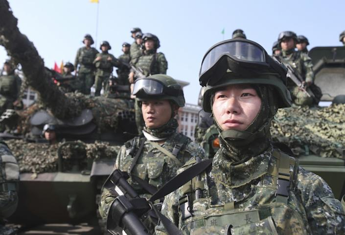 """Taiwanese soldiers pause during a Jan. 15 military exercise in Kaohsiung, Taiwan. The nation's active-duty military has shrunk to 165,000 from 275,000 three years ago. The Chinese People's Liberation Army numbers 2 million. <span class=""""copyright"""">(Chiang Ying-ying / Associated Press)</span>"""