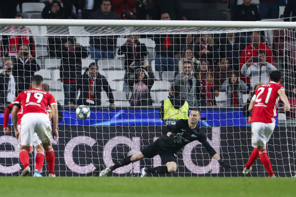 Benfica's Pizzi, right, shoots a penalty kick to score past Zenit goalkeeper Mikhail Kerzhakov his team's second goal during the Champions League group G soccer match between Benfica and Zenit St. Petersburg at the Luz stadium in Lisbon, Tuesday, Dec. 10, 2019. (AP Photo/Armando Franca)