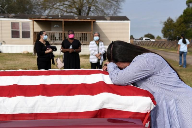 FILE PHOTO: Family and friends gather for the funeral of Gregory Blanks, who died of COVID-19