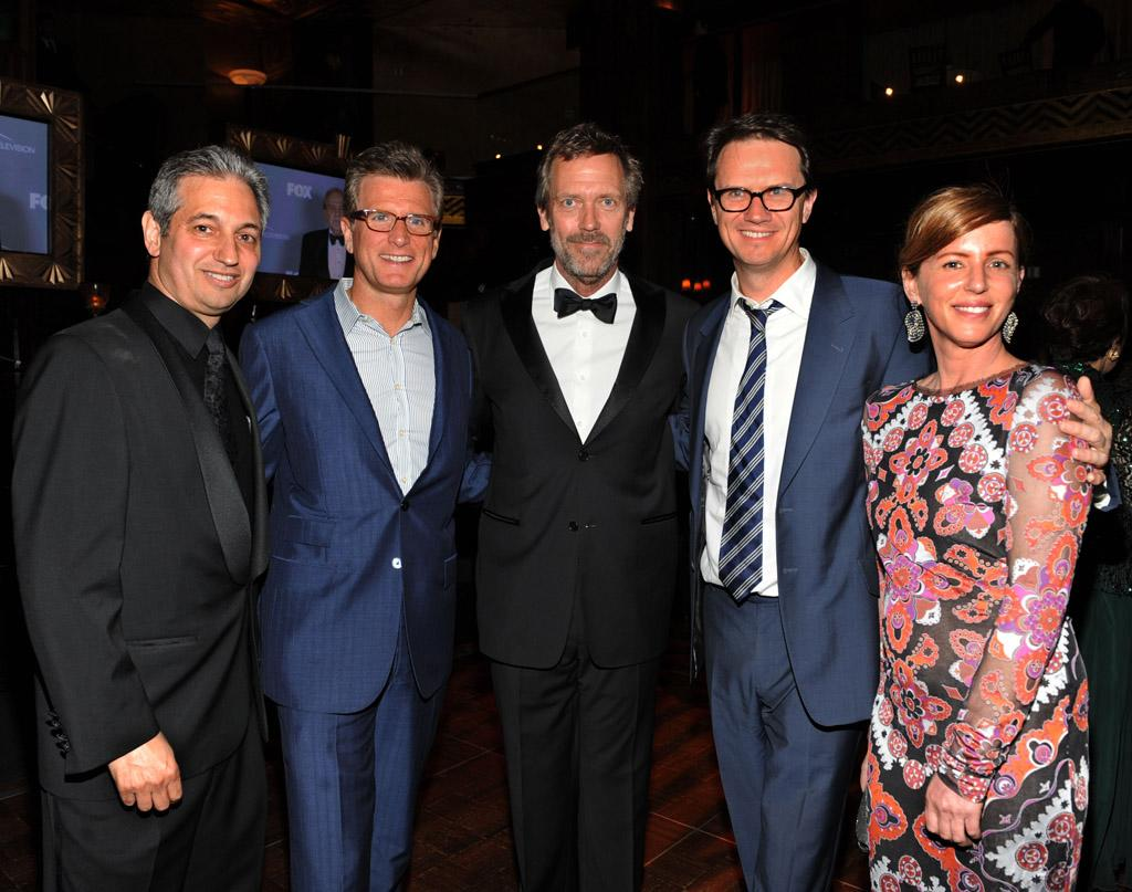 "David Shore (Creator and Executive Producer of ""House""), Kevin Reilly (President of Fox Entertainment), Hugh Laurie, Peter Rice (Chairman of Fox Networks Group), and Katie Jacobs (Executive Producer of ""House"") celebrate at the ""<a target=""_blank"" href=""http://tv.yahoo.com/house/show/36106"">House</a>"" Series Finale Wrap Party on Friday, April 20, 2012 at Cicada in downtown Los Angeles, California."