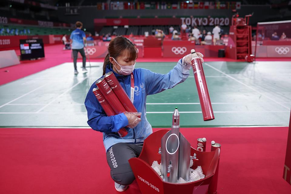 <p>A volunteer cleans and disinfects the court during badminton competition on day one of the Tokyo 2020 Olympic Games at Musashino Forest Sport Plaza on July 24, 2021 in Chofu, Tokyo, Japan. (Photo by Lintao Zhang/Getty Images)</p>