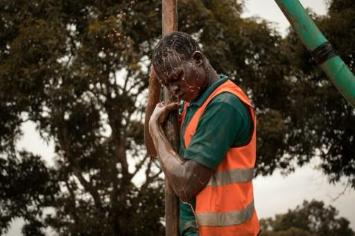 A former child soldier works on drilling a borehole in Bangui, part of a vocational programme for young victims of the Central African Republic's long conflict