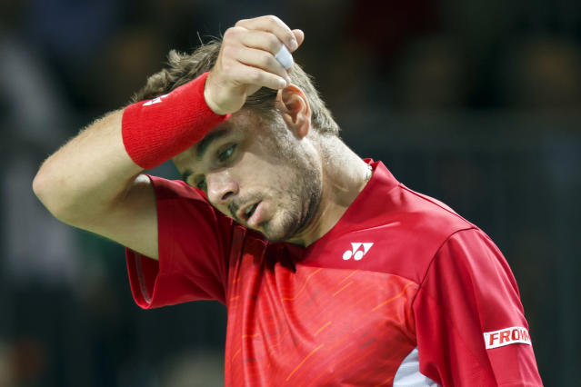 Stanislas Wawrinka of Switzerland reacts after losing a point against Andrey Golubev of Kazakhstan during the first single match of the Davis Cup World Group quarterfinal match between Switzerland and Kazakhstan, in Geneva, Switzerland, Friday, April 4, 2014. (AP Photo/Keystone, Salvatore Di Nolfi)
