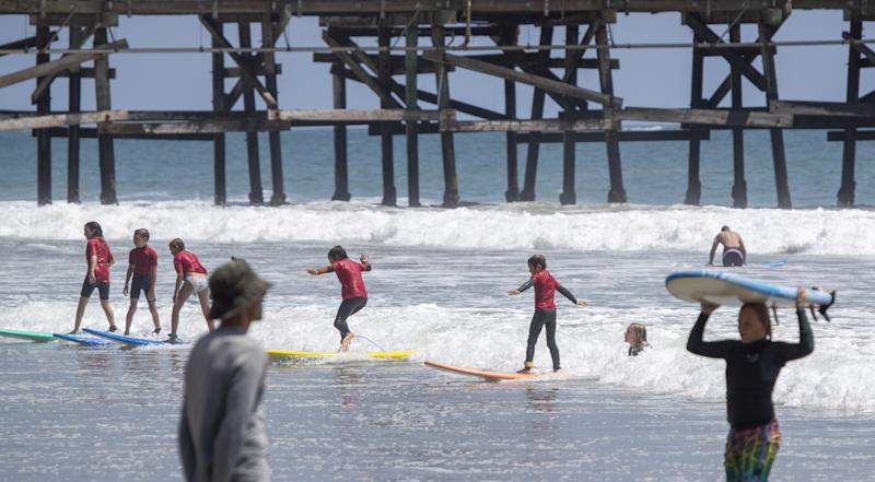 Learning to surf in San Clemente on Tuesday.