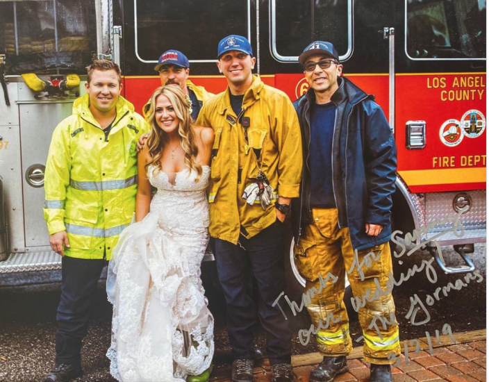 A stranded bride who was attempting to get to her wedding ceremony back in March had a special arrival complete with flashing lights and a fire engine, thanks to thesew Los Angeles County firefighters. (Photo: Courtesy of Los Angeles County Firefighters)