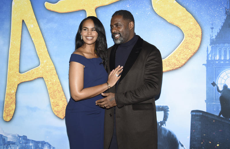 "Sabrina Dhowre Elba, left, and Idris Elba attend the world premiere of ""Cats"" at Alice Tully Hall on Monday, Dec. 16, 2019, in New York. (Photo by Evan Agostini/Invision/AP)"