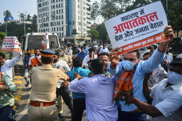 Activists and supporters of the Bharatiya Janata Party scuffle with police while protesting against the arrest of Indian television journalist Arnab Goswami