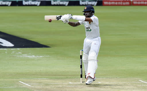 Sri Lanka's Kusal Perera plays a shot, on day one of the first cricket test match between South Africa and Sri Lanka at Super Sport Park Stadium in Pretoria, South Africa, Saturday, Dec. 26, 2020. (AP Photo/Catherine Kotze)
