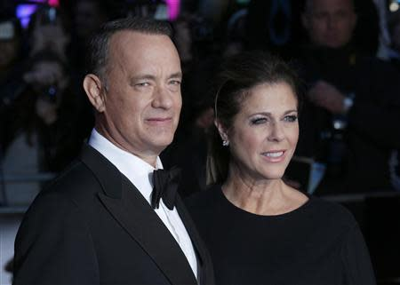 """Actor Tom Hanks and his wife Rita Wilson arrive for the European premiere of """"Captain Phillips"""", on the opening night of the London Film Festival, at the Odeon Leicester Square, in central London October 9, 2013. REUTERS/Suzanne Plunkett"""