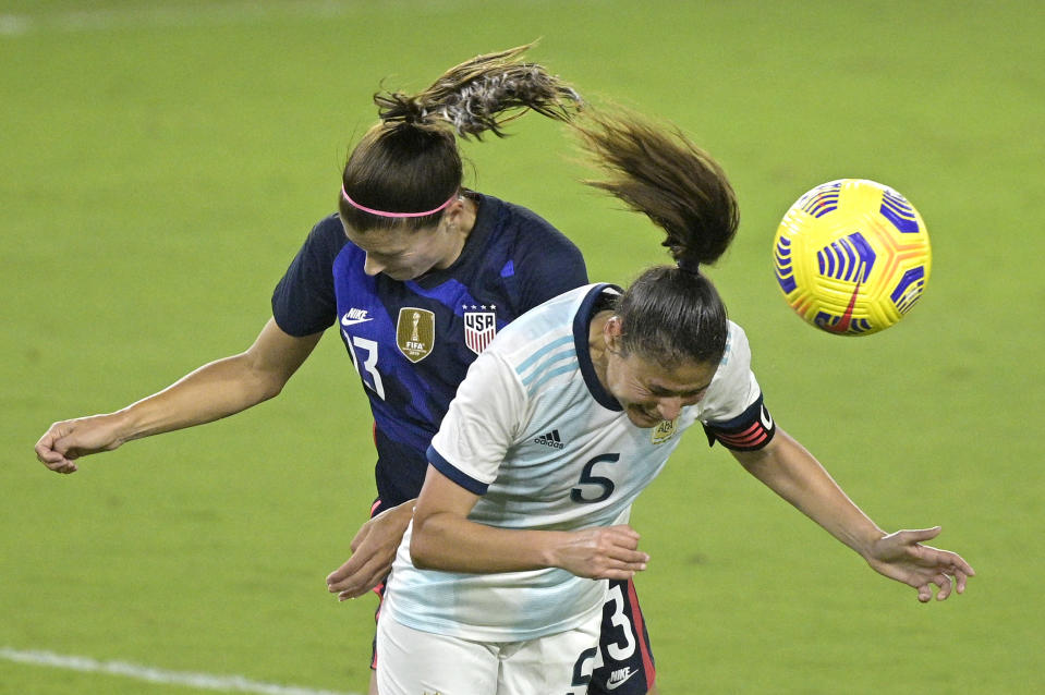 United States forward Alex Morgan (13) and Argentina midfielder Vanesa Santana (5) compete for a header during the second half of a SheBelieves Cup women's soccer match, Wednesday, Feb. 24, 2021, in Orlando, Fla. (AP Photo/Phelan M. Ebenhack)