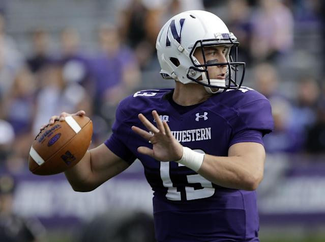 Northwestern quarterback Trevor Siemian (13) looks to a pass during the first half of an NCAA college football game against Western Illinois in Evanston, Ill., Saturday, Sept. 20, 2014. (AP Photo/Nam Y. Huh)