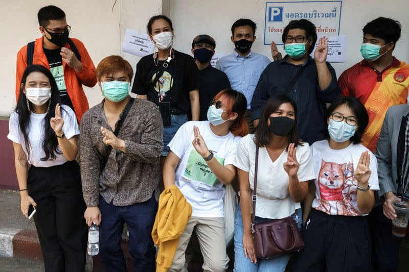 FILE PHOTO: Protest leaders arrive to report themselves at a police station in Bangkok