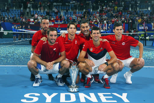 Serbia pose together with the ATP CUP after defeating Spain during their ATP Cup tennis tournament in Sydney, Monday, Jan. 13, 2020. (AP Photo/Steve Christo)