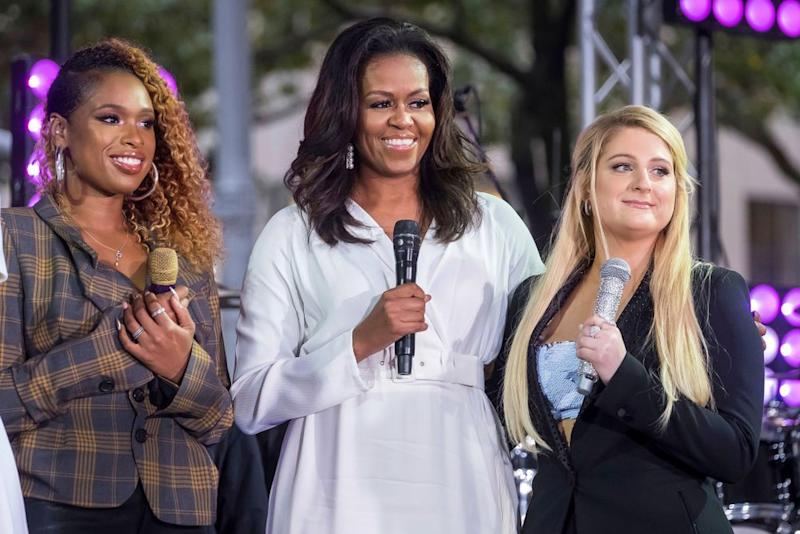 Michelle Obama (center) with Jennifer Hudson (left) and Kelly Clarkson.